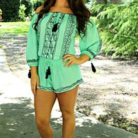 Mint romper with a navy embroidering throughout and an elastic neckline.
