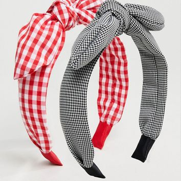 ASOS DESIGN pack of 2 headbands in mono houndstooth and red gingham print at asos.com