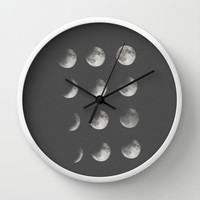 phases of the moon Wall Clock by Sara Eshak