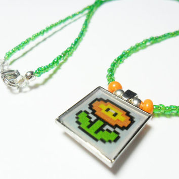 Mario fire flower necklace with green seed beads, althered art nintendo jewelry, video gamer gift,