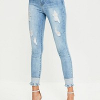 Missguided - Blue Anarchy Mid Rise Reversed Hem Skinny Jeans