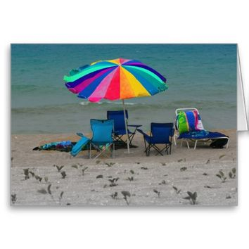 colorful beach umbrella chairs Florida scene