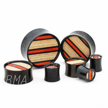 Skateboard Inlay on Black Anodized Steel Plugs (8mm-50mm)