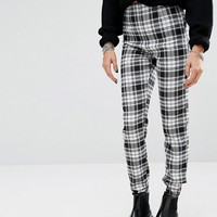 Reclaimed Vintage Fitted Pants In Black And White Check With Raw Hem at asos.com