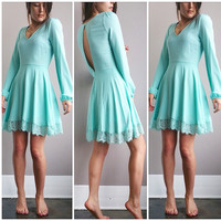 An Open Back Lace Dress in Aqua