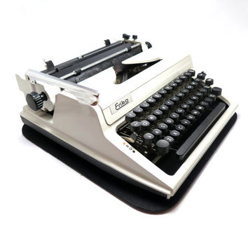 1970s Working Typewriter, Erika 105. In Very Good Cosmetic Condition and Includes Carry Leather Case with Manual. Made in Germany.