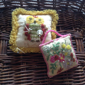 Two charming vintage pin cushions. One embroidered with an owl and the other with flowers. Vintage sewing collectibles