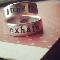 Inhale exhale ring  feather  inside aluminum spiral ring