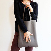Leather tote bag in grey by Leah Lerner