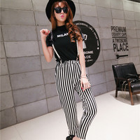 """Black """"Milan"""" Top and Black and White Vertical Striped Pants"""
