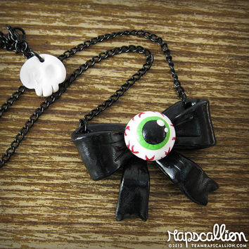 Bloodshot Eyeball Bow Necklace by rapscalliondesign on Etsy