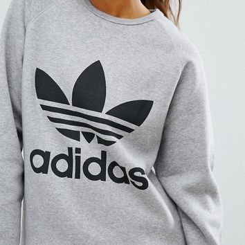 adidas Originals Grey Trefoil Boyfriend Sweatshirt at asos.com