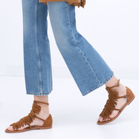 FRINGED FLAT LEATHER SANDALS