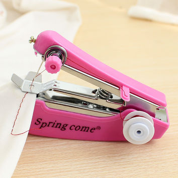 Useful Portable needlework Cordless Mini Hand-Held Clothes Fabrics Sewing Machine