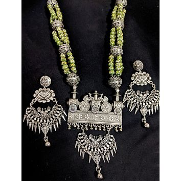 Multiple stranded wooden bead long chain necklace with designer oxidized pendant and long  Earring set