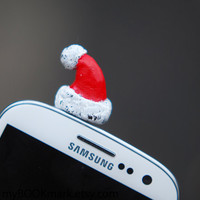 Santa hat Cell phone accessory. Christmas plug for earphone jack. Fits iPhone 5 4 4s ,iPad ,Samsung galaxy s2 s3, 3.5mm output. Oht for all