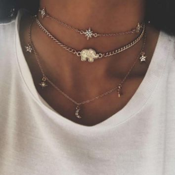 The new European and American fashion multi-layered neck chain moon star elephant pendant necklace female combination of the collarbone chain.