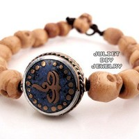 Wisdom eye brass bead and skull bone bead bracelet