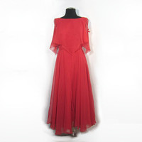 1970s carnelian red party maxi dress with draped boat neck bodie and full, ankle length skirt gown