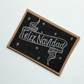Hand lettered 'Feliz Navidad' silver and black greeting card, blank holiday Kraft card, Christmas card with banner.
