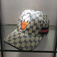 GUCCI & Donald Duck New fashion embroidery duck more letter stripe couple hat sunscreen Blue