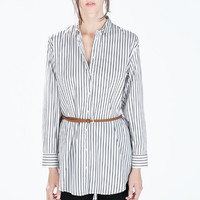 Oversize blouse with belt