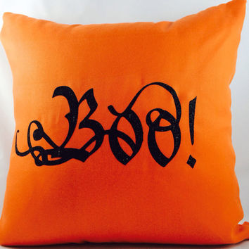 "Fall & Halloween ""BOO"" toss pillow with black glitter on orange outdoor fabric with coordinating orange chevron backing"