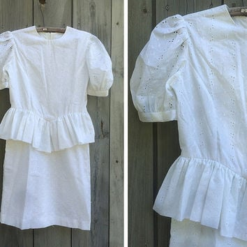 Vintage dress | White cotton lace short sleeved peplum dress