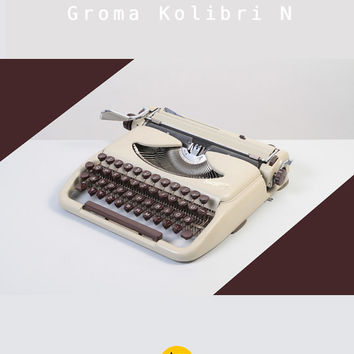Rare 1960's Groma Kolibri model N Typewriter. Refurbished & fully working. White and brown. Ultra portable. East Germany.