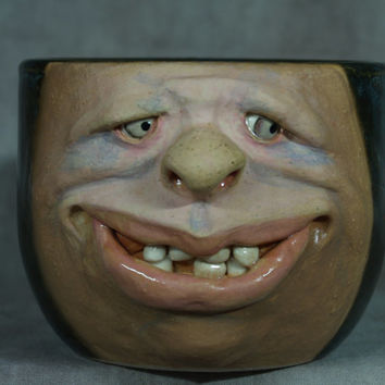 CERAMIC MUG, wheel thrown, hand altered and sculpted. Just a friendly face to enjoy your morning beverage with.