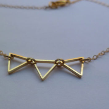 Tiny bunting necklace outline in gold by littlepancakes on Etsy