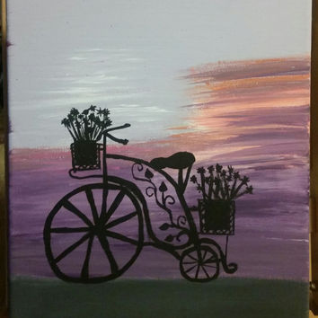 Hand painted wood framed canvas.  Sunset ride
