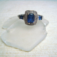 Vintage sterling silver ring with baguette blue stone and marcasite detail, size 7.5