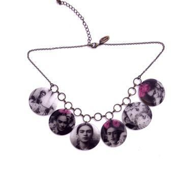 It's a conversation piece of jewelry with The Frida kahol Charm Necklace, featuring an