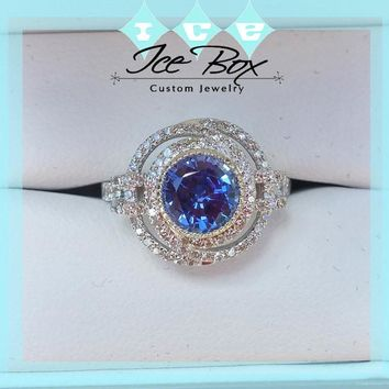 Cultured Blue Sapphire 6.5mm, 1.4ct Round bezel set in a 14K White Gold Knot Setting