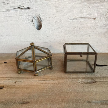 Two small brass and glass display cases.