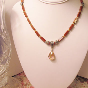 Pink Crystal Teardrop Pendant on Goldstone Necklace