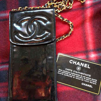 Vintage CHANEL black patent enamel leather mini pouch purse with golden shoulder strap for iPhone, cigarettes, coins, card, and makeups.
