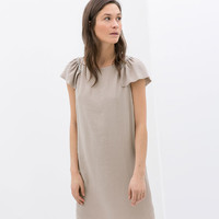 DRESS WITH CHAIN SHOULDER