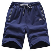 NIKE summer thin section men's sports and leisure beach pants blue