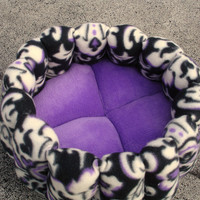 Dog bed or cat bed 14 inch round in a purple  black and white fleece and microplush fabric