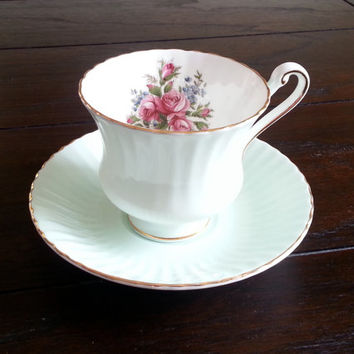 Vintage Paragon mint green tea cup and saucer set with floral transfer detail