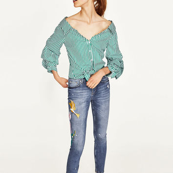 JEANS WITH EMBROIDERED BIRD