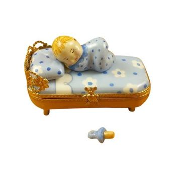 BABY IN BLUE BED W/ PACIFIER LIMOGES BOXES