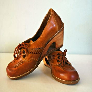 1970's caramel platform leather shoes with unique wooden cut out wedge and lace up front. Size US 7, Australian 5.5, European 37.5