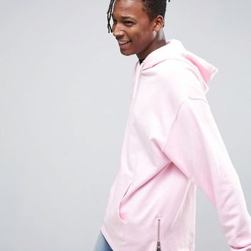 ASOS Oversized Longline Hoodie With Side Zips in Pink at asos.com