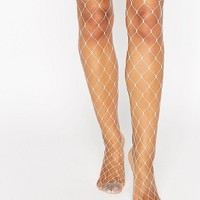 ASOS Oversized Fishnet Tights at asos.com