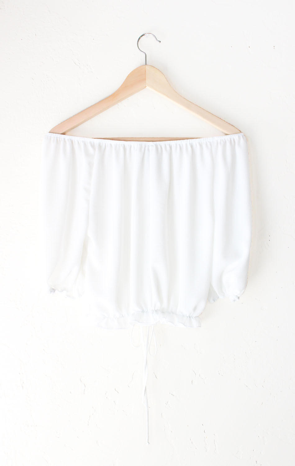 d302adff66dfd Ruffled Off Shoulder Crop Top - White from NYCT Clothing