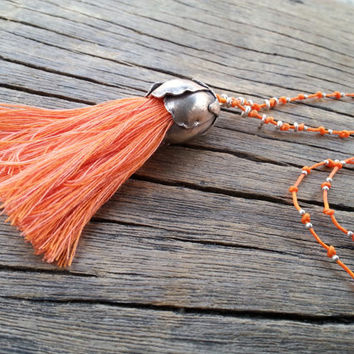 Long Tassel Necklace Orange Cotton Tassel in Large Sterling Silver Flower Calyx, Waxed Linen Thread Necklace with Tiny Sterling Silver Beads