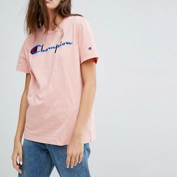 Champion Oversized T-Shirt With Front Logo at asos.com
